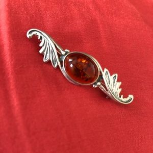 Silver and amber brooch pin